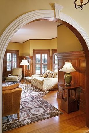 Traditional Living Room with Crown molding, Ballard Design Luciana Table Lamp Base, Laminate floors, Bell Lamp Shade