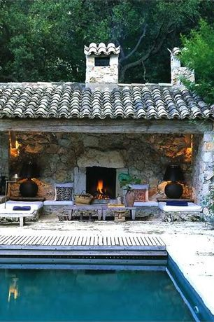 Mediterranean Swimming Pool with Outdoor chaise lounge, Spanish style roof, stone fireplace, Outdoor pool, Wall sconce