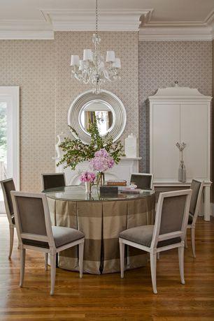 Traditional Living Room with Laminate floors, Crown molding, interior wallpaper, Chandelier, Glass panel door