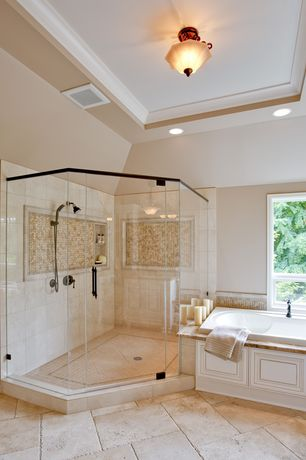 Traditional Master Bathroom with Tray ceiling, Porcelain tile, travertine tile floors, frameless showerdoor, flush light