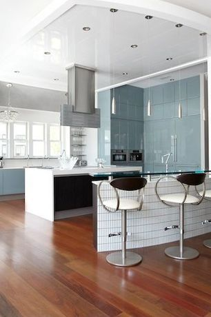 Contemporary Kitchen with Island Hood, Casement, Adjustable Height Bar Stool by Chintaly Imports, can lights, Solis Lamp