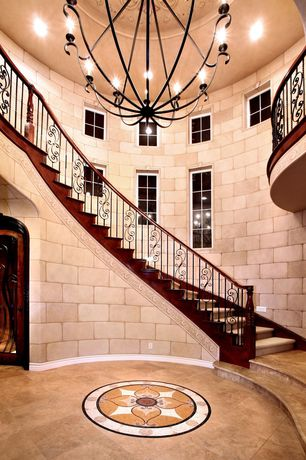 Mediterranean Staircase with Derrymore chandelier design by currey & company, Wrought iron railing, High ceiling, Loft