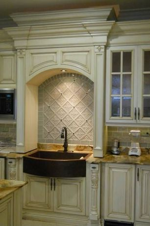 "Traditional Kitchen with Crown molding, Complex granite counters, Large Ceramic Tile, Glass panel, 33"" copper farmhouse sink"