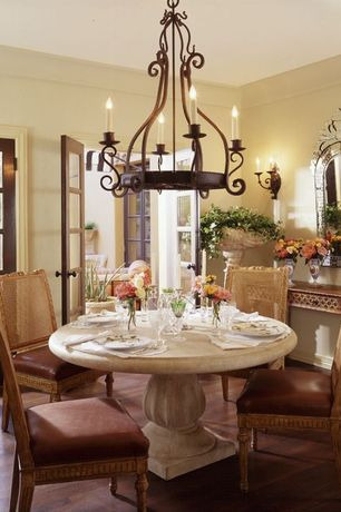 Traditional Dining Room with Chandelier, Crown molding, Wall sconce, Laminate floors, French doors