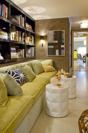 Contemporary Living Room with Built-in bookshelf, flush light, Ceramic stool white, Wall sconce, Laminate floors
