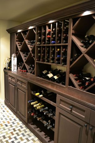 Traditional Wine Cellar with can lights, Built-in bookshelf, Interlocking Pavers, Standard height