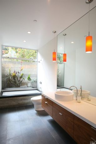 Contemporary Master Bathroom with Pendant light, Limestone counters, European Cabinets, Flush, Custom Mirror Panel