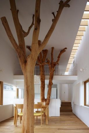 Eclectic Dining Room with natural wood posts, Interior tree, Paint 1