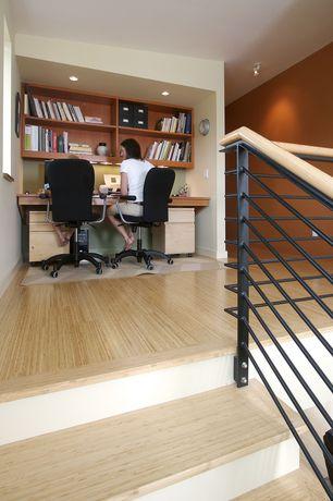 Modern Home Office with Bamboo floors, Built-in bookshelf, flush light