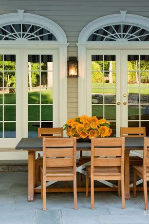 Traditional Patio with French doors, exterior tile floors, Transom window