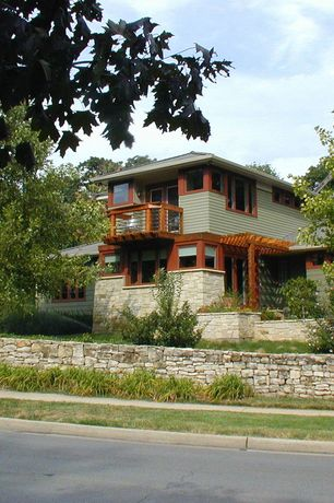 Contemporary Exterior of Home with Paint 2, Stacked stone retaining wall, Paint 1, Trellis