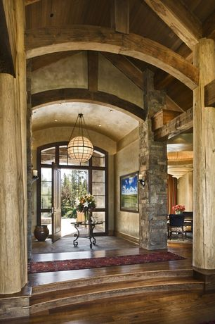 Rustic Entryway with Cathedral ceiling, Chandelier, Hardwood floors, can lights, Exposed beam, slate floors, specialty door