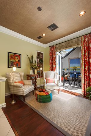 Tropical Living Room with can lights, Hardwood floors, French doors, Standard height, Crown molding