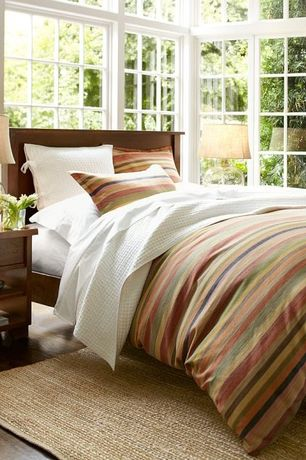 Guest Bedroom with Pottery barn logan stripe duvet cover & sham, Pottery barn sumatra ii bed, High ceiling, Laminate floors