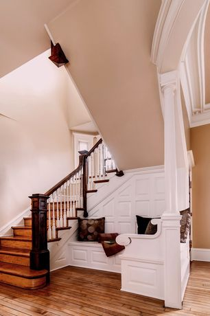 Traditional Staircase with Interior white columns, Custom built-in bench seating
