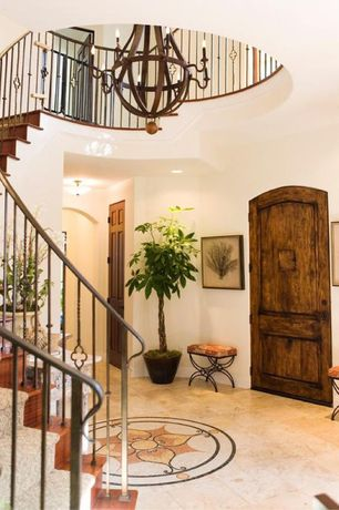 Mediterranean Entryway with flush light, Rustic wood door, six panel door, curved staircase, can lights, Loft, High ceiling