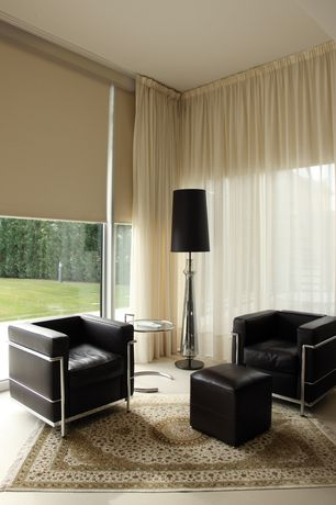 Contemporary Living Room with Classicon adjustable table e1027, Hunter Douglas Alustra Screen Shade