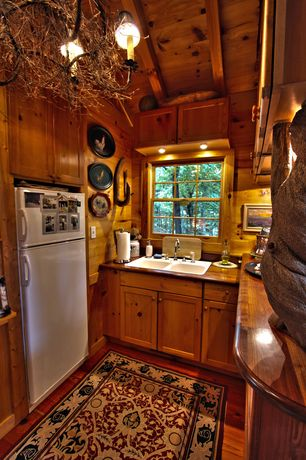 Rustic Kitchen with Wood countertops, Wood paneled wall, Double bowl self rimming sink, Wood paneled ceiling