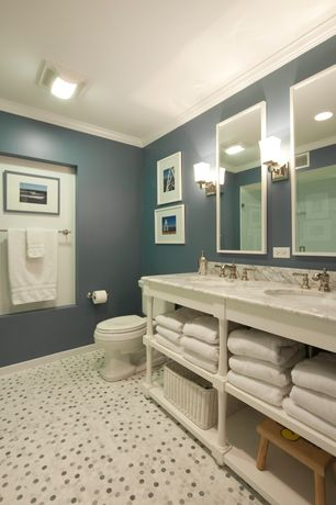 Traditional Full Bathroom with Complex marble counters, Double sink, penny tile floors, Crown molding, Rain shower