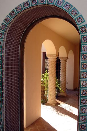 Mediterranean Entryway with Columns, Arched doorway