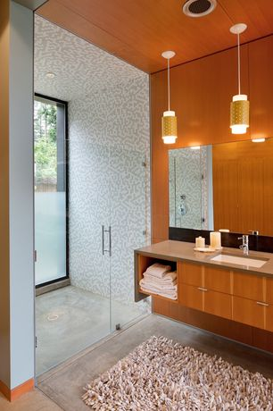 Modern 3/4 Bathroom with frameless showerdoor, Whitehaus Luxe Lavatory Faucet, European Cabinets, Complex granite counters
