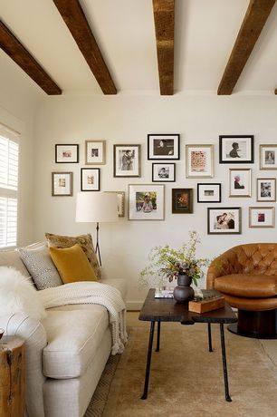 Contemporary Living Room with Exposed beam, West Elm Jute Chenille Herringbone Rug, Gallery wall, Serena & Lily Bruno Chair