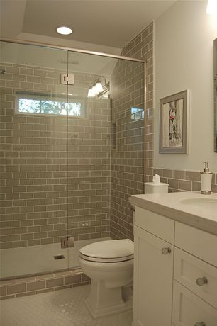Traditional Full Bathroom with Flat panel cabinets, Undermount sink, Wood counters, Frameless, penny tile floors