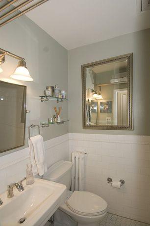 Traditional Powder Room with Vanity light, Pedestal sink, Uttermost stuart mirror, penny tile floors, Powder room