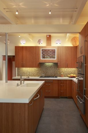 Contemporary Kitchen with Simple Granite, Kitchen island, Dupont Corian Designer White, Corian counters, L-shaped, Flush