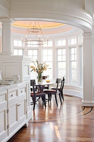 Traditional Dining Room with Crown molding, Casement, High ceiling, Built-in bookshelf, Chandelier, Laminate floors