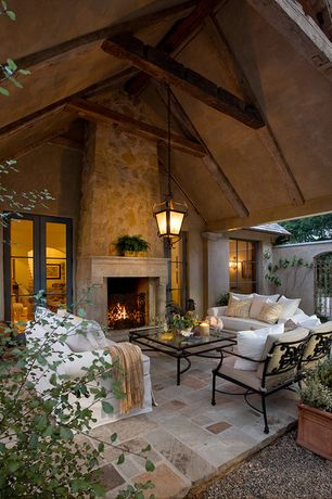 Mediterranean Porch with Fence, Casement, exterior stone floors, Raised beds, French doors