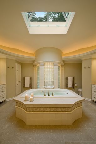 Traditional Master Bathroom with Travertine counters, European Cabinets, Skylight, Crown molding light, Flat panel cabinets
