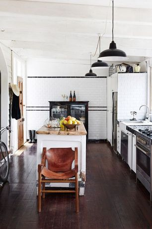 Country Kitchen with Wood counters, specialty door, One-wall, Hardwood floors, Pendant light, double dishwasher, Flush