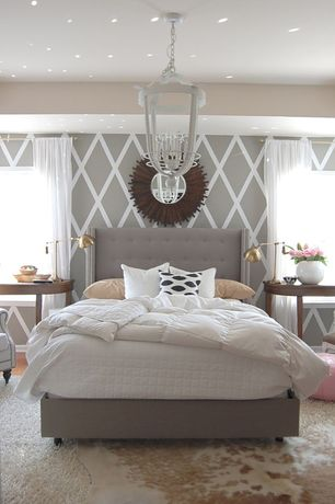 Contemporary Master Bedroom with Paint 2, Diamond pattern wall, Carpet, Cow hide rug, Chandelier, Standard height, Art desk