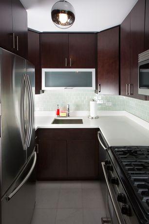 Contemporary Kitchen with U-shaped, Flush, Undermount sink, limestone tile floors, Viso - bolio mirror pendant light