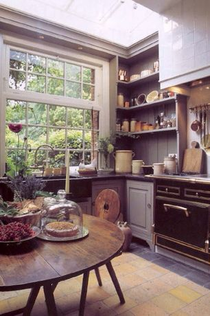 Eclectic Kitchen with Raised panel, stone tile floors, Custom hood, Large Ceramic Tile, Casement, Farmhouse sink, flush light