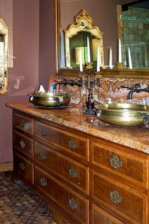 Traditional Full Bathroom with Vessel sink, penny tile floors, Onyx, Flat panel cabinets, Double sink, frameless showerdoor