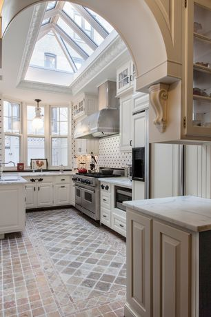 Traditional Kitchen with Built In Panel Ready Refrigerator, stone tile floors, Glass panel, Wall Hood, wall oven, Bay window