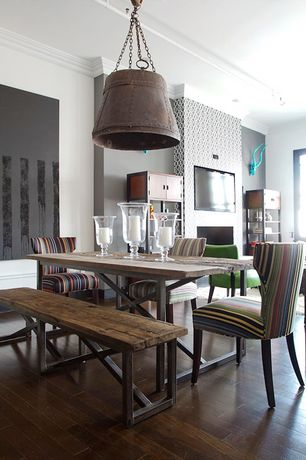 Contemporary Dining Room with Hardwood floors, Crown molding, Pendant light, Standard height