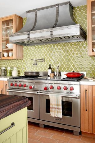 Country Kitchen with European Cabinets, Flush, Wood countertop, terracotta tile floors, Corian counters, Glass panel