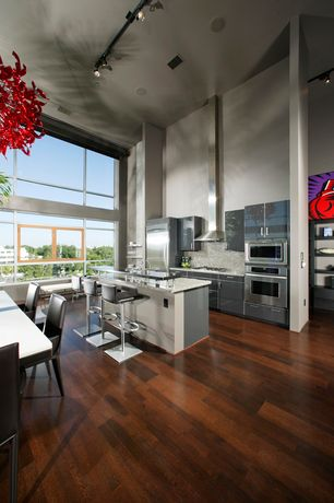 Modern Kitchen with Simple Granite Tile, Red Blown Glass Chandelier, Lustra Wenge Bent Wood Adjustable Barstool, Flush