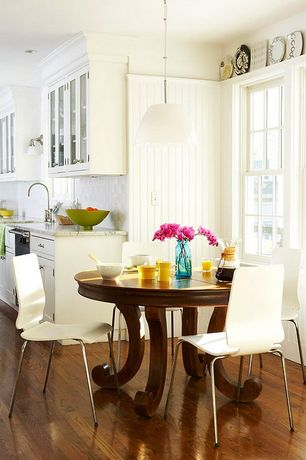 Traditional Dining Room with Hardwood floors, Standard height, double-hung window, Paint, Pendant light, Paint 2