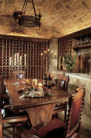 Rustic Wine Cellar with Chandelier, limestone floors, Built-in bookshelf