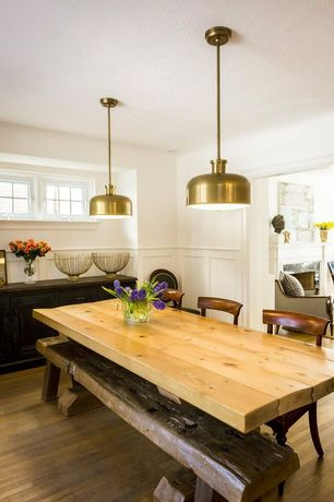 Eclectic Dining Room with Wainscotting, Standard height, Hardwood floors, Pendant light, Casement