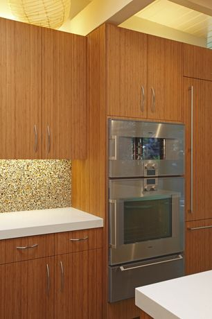 Modern Kitchen with Flush, Exposed beam, European Cabinets, Simple Granite, One-wall, double wall oven, full backsplash