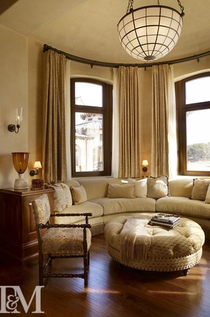 Traditional Living Room with Hardwood floors, bedroom reading light, Wall sconce, Standard height, Casement, flush light