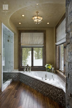 Rustic Master Bathroom with can lights, Standard height, Chandelier, drop in bathtub, interior wallpaper, Master bathroom