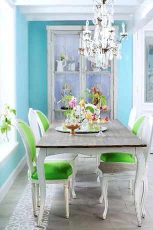 Eclectic Dining Room with Concrete tile , Standard height, Chandelier, Exposed beam