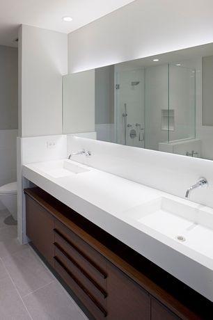 Modern Master Bathroom with Large Ceramic Tile, Arizona Tile Diamond White Quartz, Flush, Handheld showerhead, Double sink