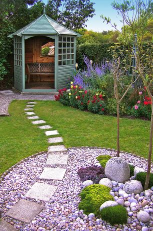Traditional Landscape/Yard with Rainbow Pebbles, Gazebo, Fence, Raised beds, Pathway, Rainbow Pebbles, exterior stone floors